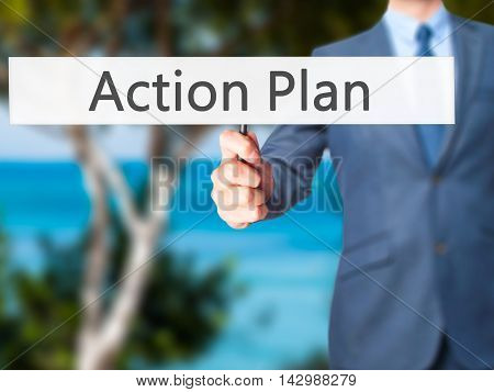Action Plan - Business Man Showing Sign