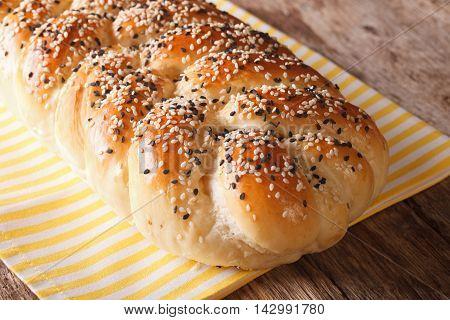 Tasty Braided Bun With Sesame Seeds Closeup. Horizontal