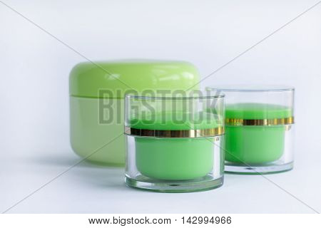 Cosmetic set of facial and hair care bottles