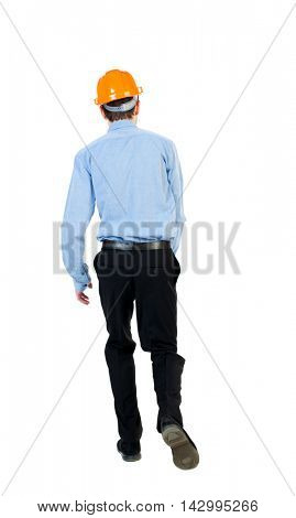 Back view of running engineer in helmet. Walking guy in motion. Rear view people collection. Backside view of person. Isolated over white background. Businessman in a blue shirt and a helmet runs into