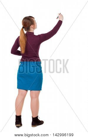 back view of writing beautiful woman. Young girl in dress. Rear view people collection.  backside view of person. Isolated over white background.  Girl with red hair tied in a pigtail tip pen writes