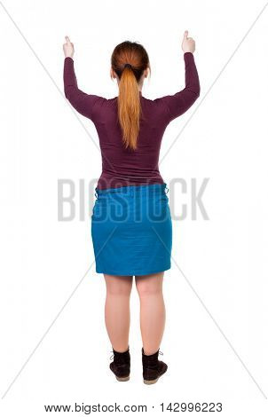 Back view of  woman thumbs up. Rear view people collection. backside view of person. Isolated over white background. The red-haired girl in a blue skirt with both hands showing thumb up.