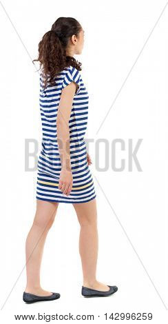 back view of walking  curly woman.  backside view of person.  Rear view people collection. Isolated over white background. Swarthy girl in a checkered dress thoughtfully out into the distance.