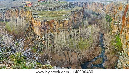 The amazing view on the bend of Ihlara gorge with the narrow Melendiz river and winter forest stretching along its bottom Cappadocia Turkey.