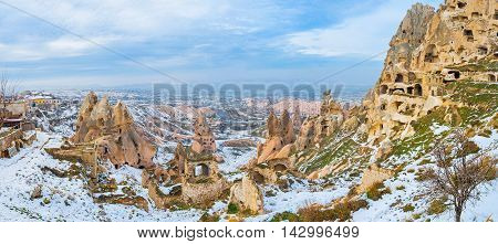 The open air museum located in the center of Uchisar settlement and consists of the Castle carved in giant rock formation and chambers and houses in smaller rocks Cappadocia Turkey.