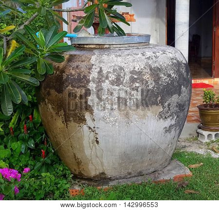 traditional giant rain water storage jar at a southern rural Thai house near Songkhla, Thailand