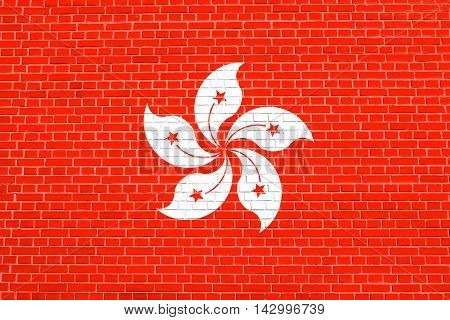 Flag of Hong Kong on brick wall texture background. The Hong Kong is special administrative region of the People's Republic of China. 3D illustration