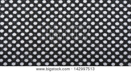 Dark knitted fabric with white polka dots background