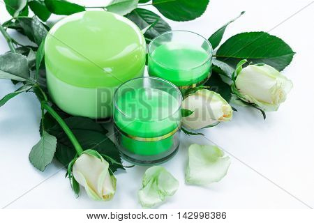 Cosmetic set of 3 cream bottles with roses