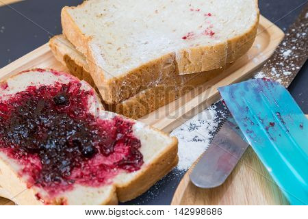 Bread And Blackcurrant Jam On Wood Plate