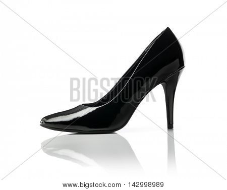 Black shiny stiletto heel women's pump shoe on white.