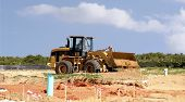 picture of land development  - A single bulldozer working on a construction site - JPG