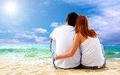 pic of couple sitting beach  - Sea view of a couple sitting on beach - JPG