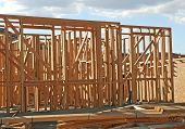 foto of 2x4  - A new home under construction with framing of 2x4 - JPG