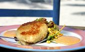 foto of crab-cakes  - Crabcakes with smokey avocado corn relish served al fresco style near Islamorada Florida - JPG