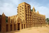 stock photo of dogon  - A side view of a mud mosque in a Dogon village in Mali - JPG