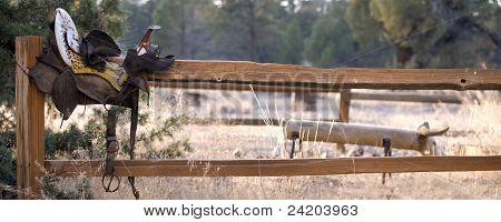 Old Saddle On Split Rail Fence Panoramic