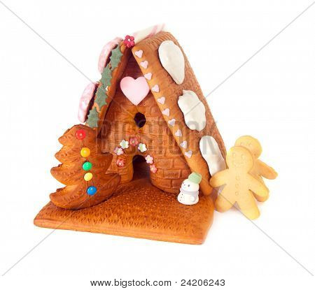 Isolated gingerbread house with candy and gingerbread men