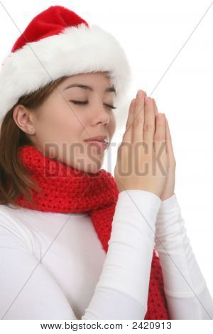 Girl Praying At Christmas