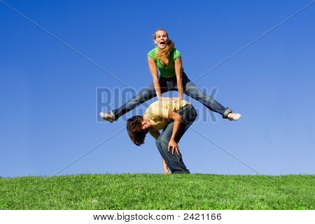 Happy Smiling Youth Playing At Leapfrog