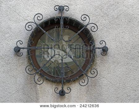 Round Window In Rough Plastering
