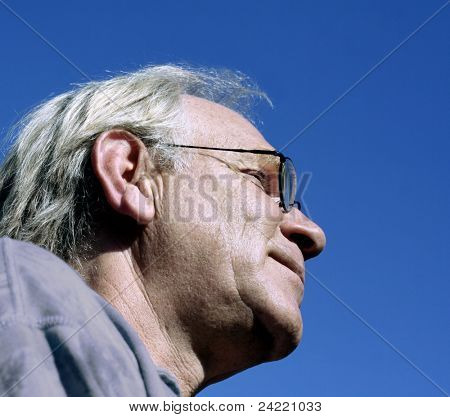 Man profile on blue sky
