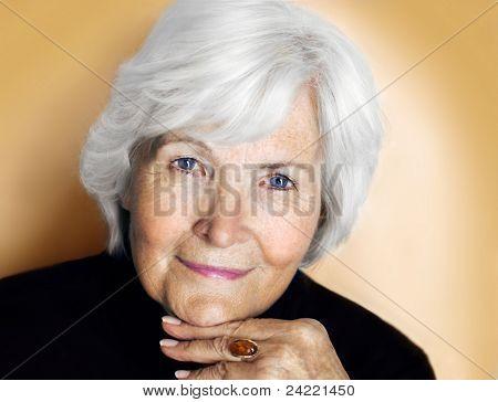 Senior lady portrait on pastel yellow background