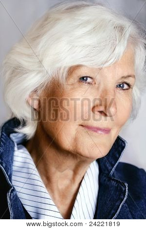 Beautiful senior woman portrait with fashion dress