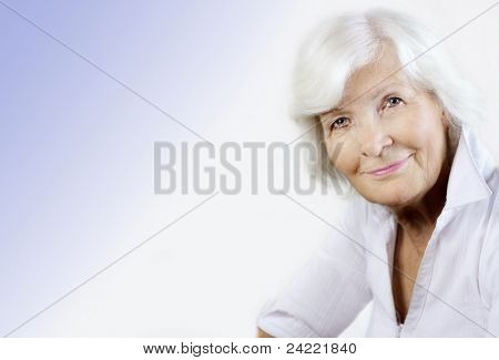 Gracious senior woman portrait with copy-space