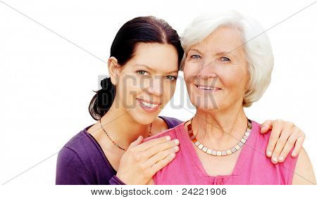 Grandmother and granddaughter embraced  on white background