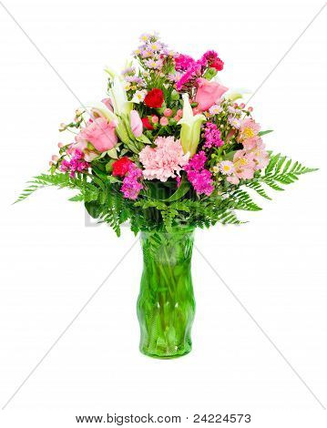 Fresh, colorful professional flower arrangement in green glass vase isolated on white