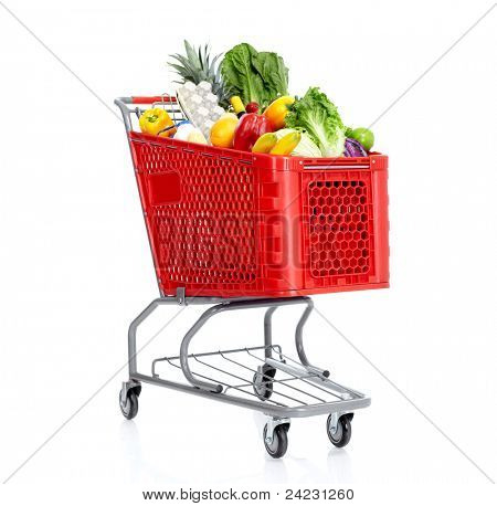 Red shopping cart with grocery items. Isolated over white background.