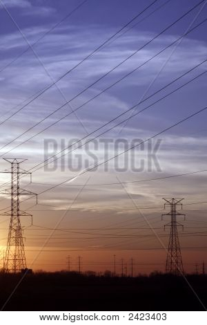 High Powerlines At Sunset