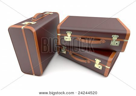 Three dark vintage suitcases