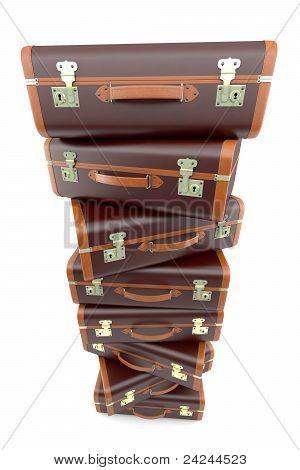 Pile of vintage dark suitcases