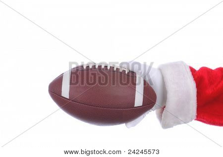 Santa Claus outstretched arm with an american football ready to hand off. Horizontal format over a white background.