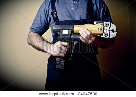 retro image of plumber with electric tool