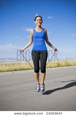 Attractive Women Exercising and Jumping Rope