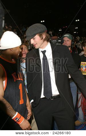 LOS ANGELES - FEB 13: Ashton Kutcher, Nelly at the NBA All Star Celebrity Game on February 13, 2004 at the Los Angeles Convention Center in Los Angeles, California