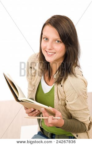 Student Teenager Girl Holding Books Looking Up