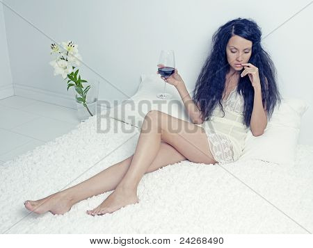 Elegant Lady With A Glass Of Wine
