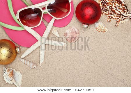 Christmas balls,seashells and  with beach accessories on sands,Closeup.