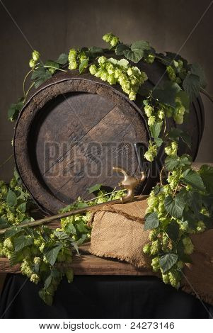 hop cones and old barrel
