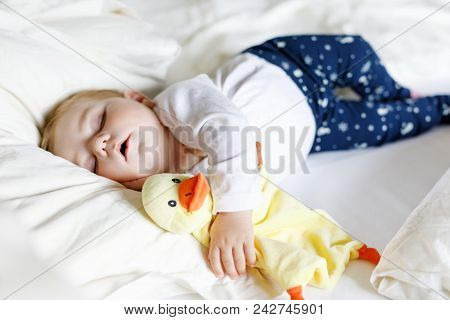 poster of Cute Adorable Baby Girl Of 6 Months Sleeping Peaceful In Bed At Home. Closeup Of Beautiful Calm Chil