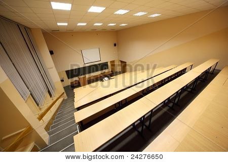 Classroom, university lecture hall; big blackboard, wooden desks and benches