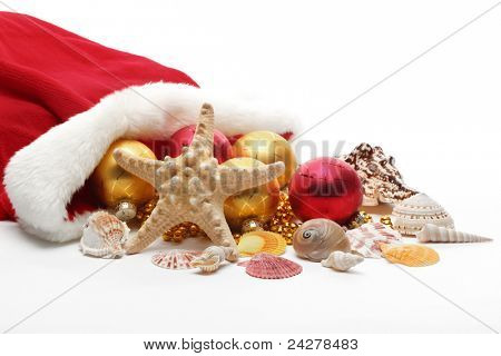 Santa Claus bag with balls and seashells,Isolated on white.