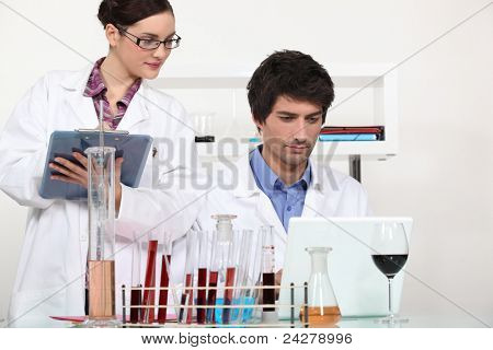 Couple working in a wine laboratory