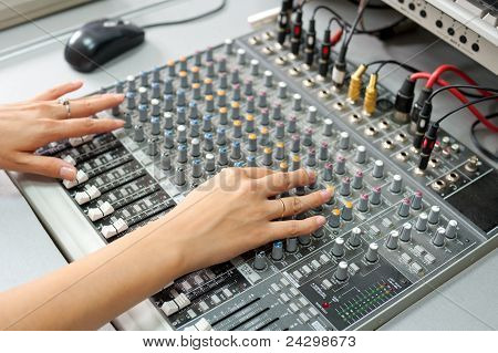 Female Hands At Audio Control Console