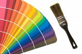 foto of paint brush  - A vibrant fan deck of color cards with a paint brush provides a concept for any decorating and remodel promotion - JPG