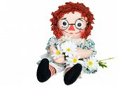 stock photo of rag-doll  - Old rag doll with daisy bouquet isolated on white - JPG